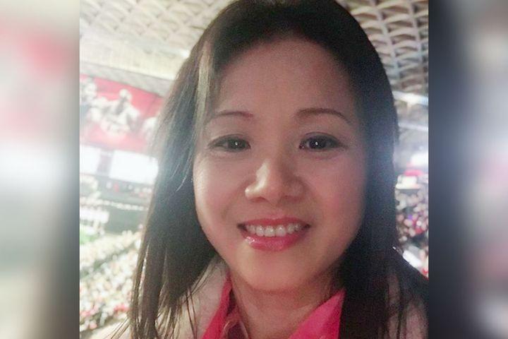 """Xiaojie """"Emily"""" Tan"""