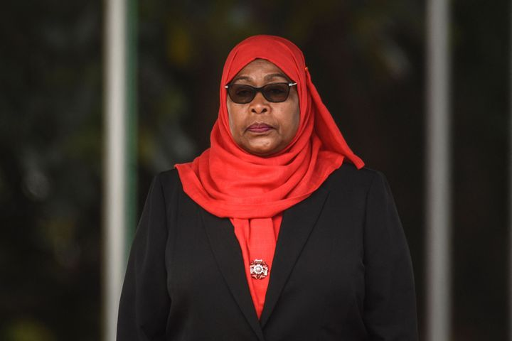 Tanzanian President Samia Suluhu Hassan inspects a military parade following her swearing in the country's first female presi