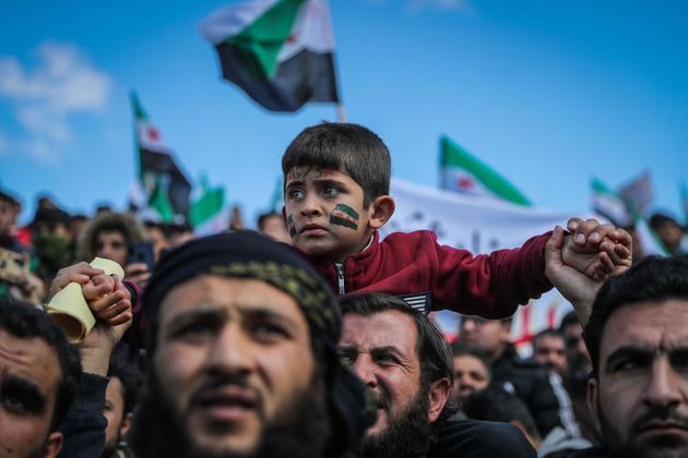 18 March 2021, Syria, Idlib: Syrians attend a mass demonstration commemorating the so-called 'Siege of...