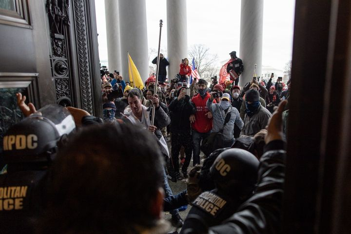 Police intervene as Trump supporters attempt to enter the Capitol building on Jan. 6.