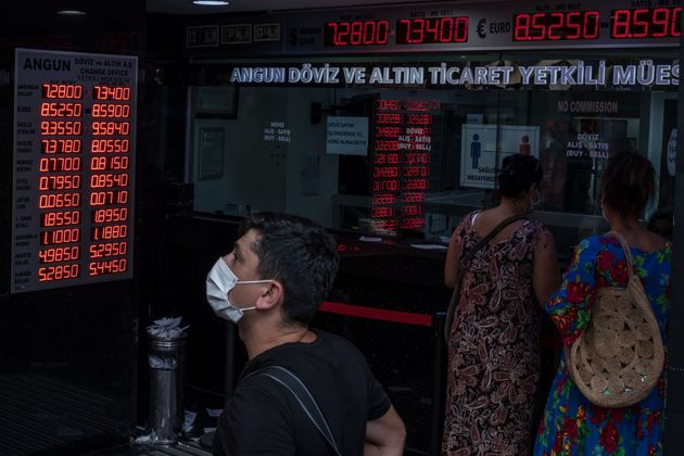 ISTANBUL, TURKEY - AUGUST 07: People wait to exchange money at a currency exchange shop on July 07, 2020...