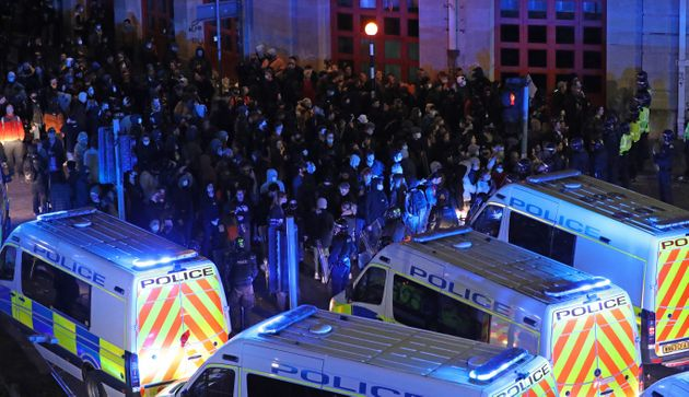 Riot police, with police horses and police vehicles, move down Rupert Street in Bristol towards