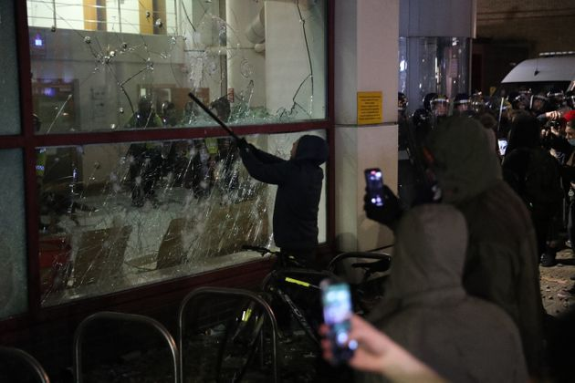 Protester smashes a Bridewell Police Station window as they take part in a 'Kill the Bill' protest in