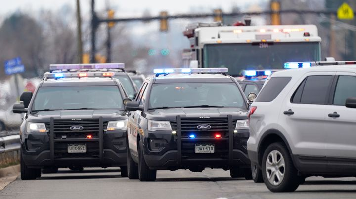 Police cars are parked outside a King Soopers grocery store where a shooting took place Monday in Boulder, Colorado.