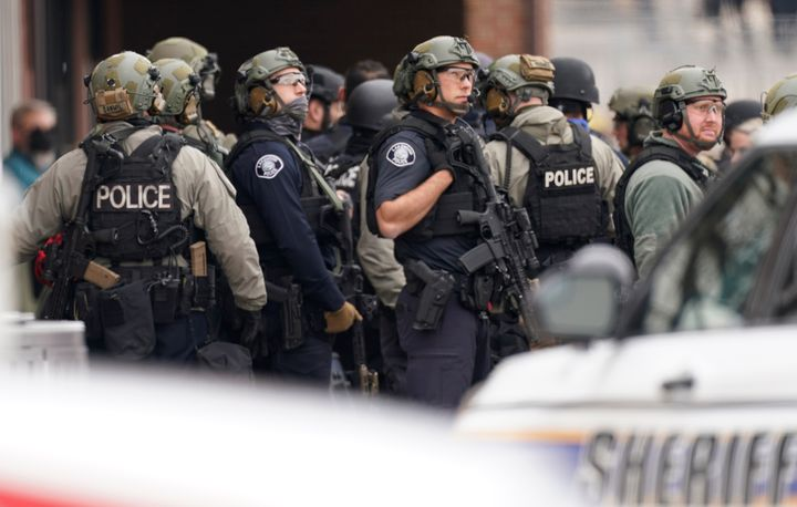 Police in tactical gear gather at the King Soopers grocery store in Boulder.
