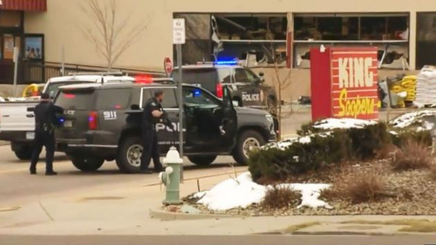 Police take positions outside the King Soopers grocery store in Boulder, Colorado, on Monday after reports...