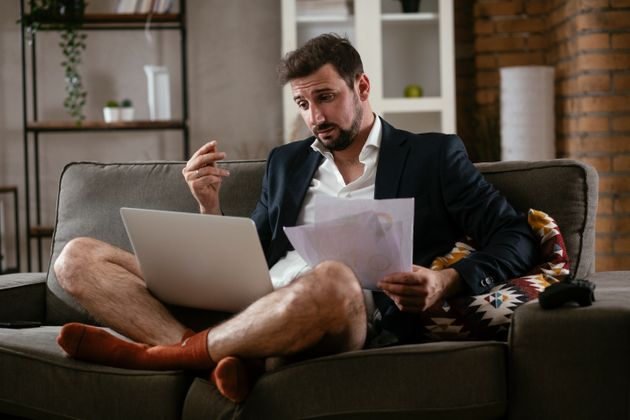 Businessman working online, wearing suit and no pants. Young man having video call. Businessman working...