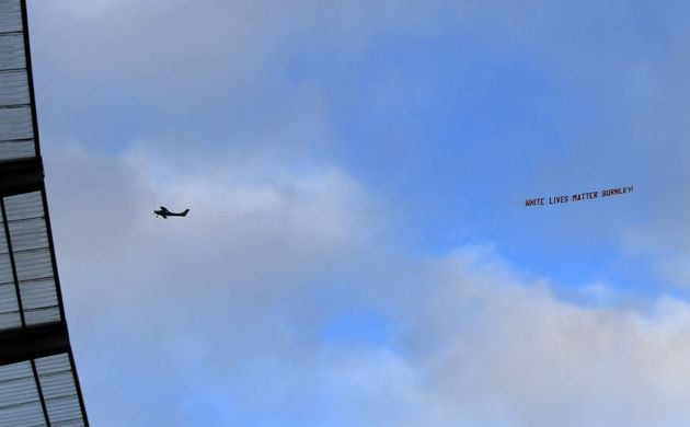 MANCHESTER, ENGLAND - JUNE 22: A plane flies over the stadium with a banner reading 'White Lives Matter...