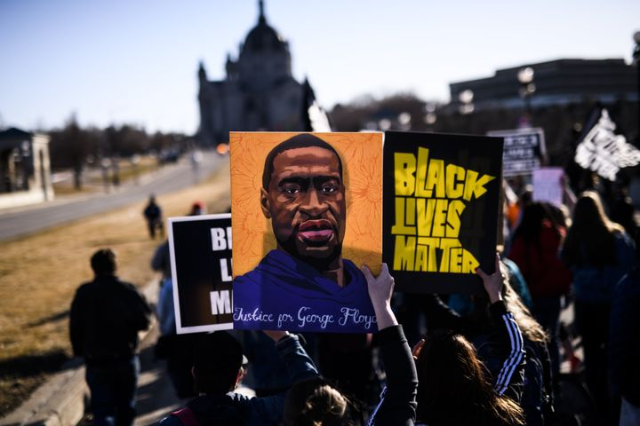 ST PAUL, MN - MARCH 19: People march near the Minnesota State Capitol to honor George Floyd on March 19, 2021 in St Paul, Min