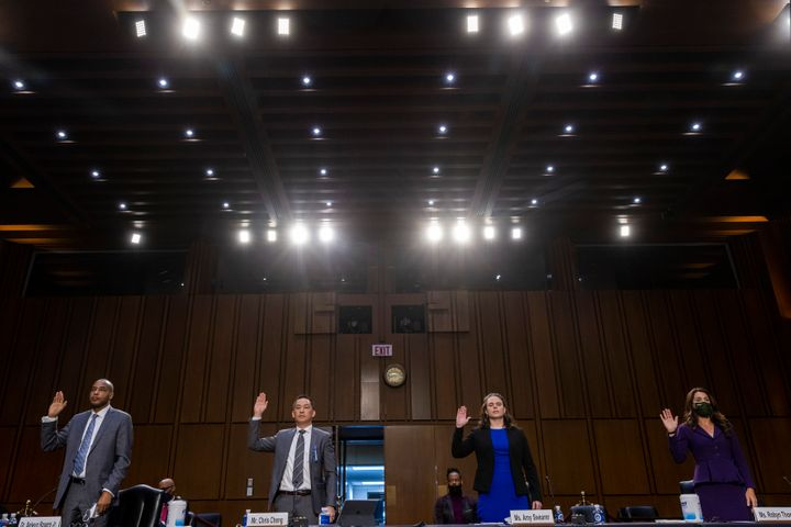 Witnesses are sworn in at the Senate Judiciary Committee hearing on gun violence on March 23, 2021.