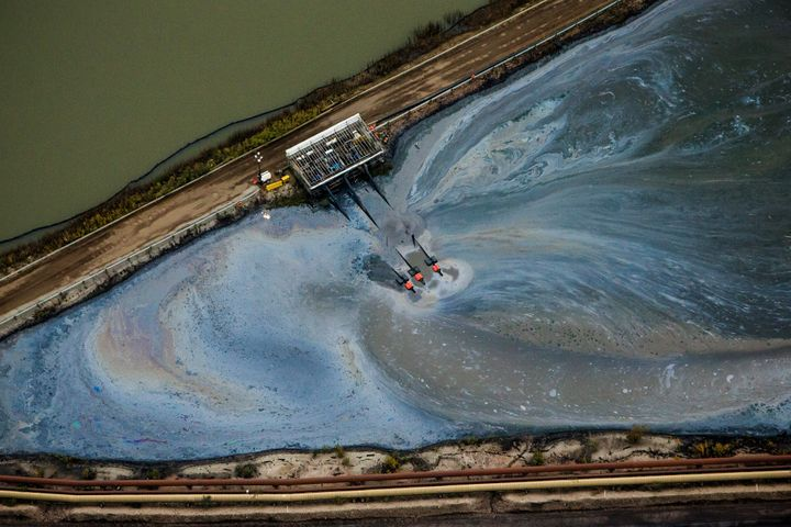 Aerial view of operations at the Athabasca oil sands near Fort McMurray, Alberta, Canada. Tar sands extraction causes signifi