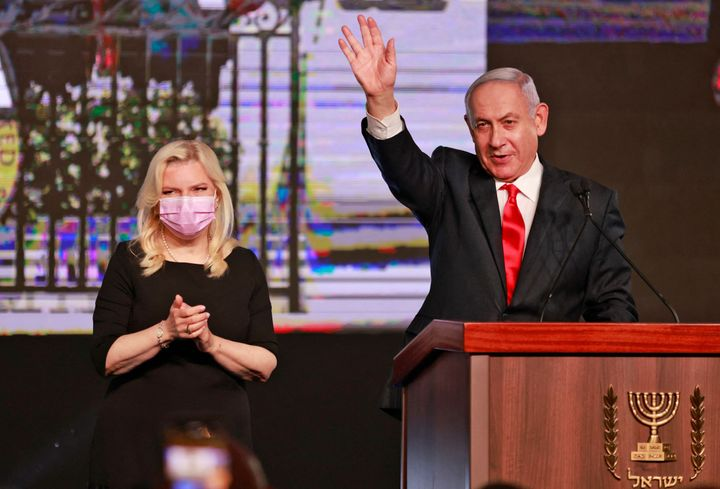 Israeli Prime Minister Benjamin Netanyahu, leader of the Likud party, appears with his wife Sara to address supporters at the