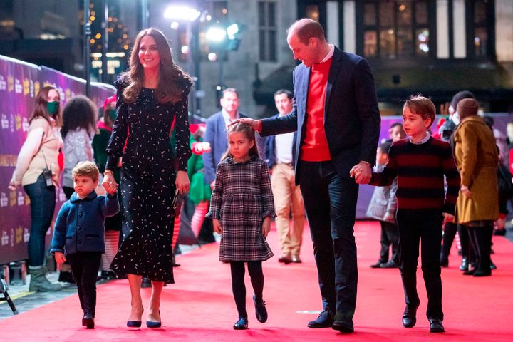 Prince William, Duke of Cambridge, his wife Britain's Catherine, Duchess of Cambridge, and their children Britain's Prince George of Cambridge (R), Britain's Princess Charlotte of Cambridge (3rd L) and Britain's Prince Louis of Cambridge (L) arrive to attend a special pantomime performance of The National Lotterys Pantoland at London's Palladium Theatre in London on December 11, 2020, to thank key workers and their families for their efforts throughout the pandemic. (Photo by Aaron Chown / POOL / AFP) (Photo by AARON CHOWN/POOL/AFP via Getty Images)