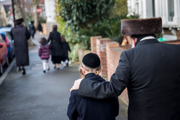 A file image showing members of the Jewish community walk along the street in Stamford