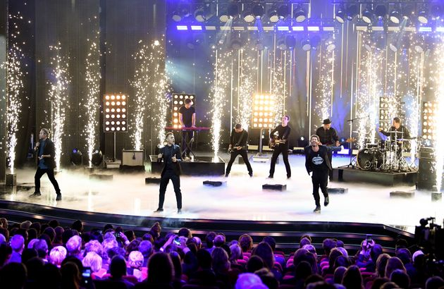 Take That performing live in