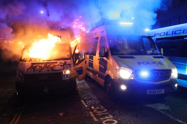 A vandalised police van on fire outside Bridewell Police Station, on