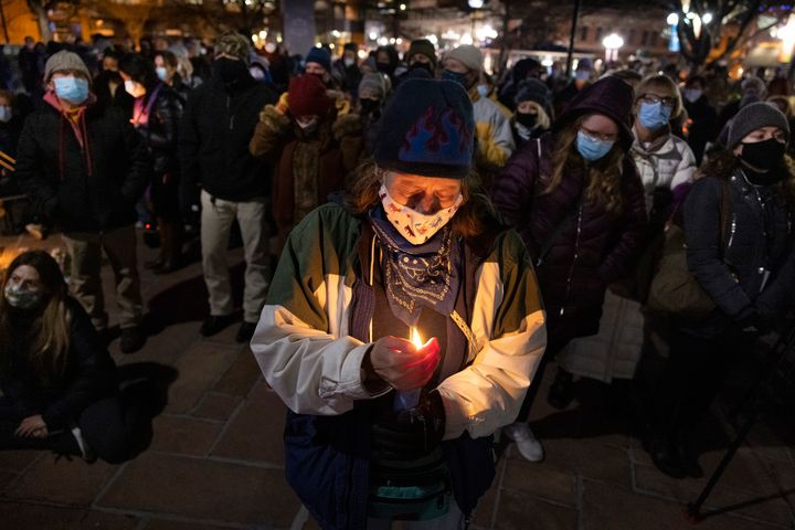 Boulder residents attend a candle light vigil honoring the 10 people who were killed on March 24, 2021 in Boulder, Colorado.