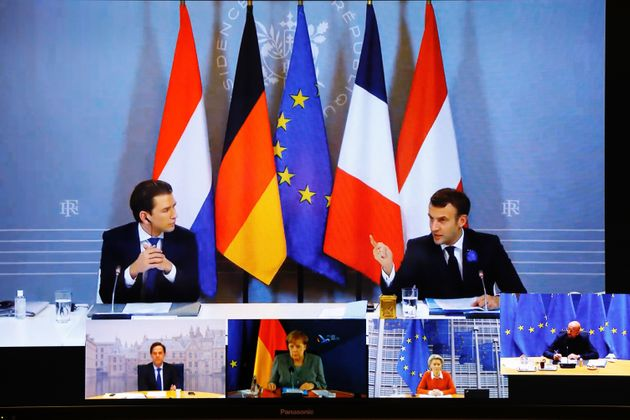 French President Emmanuel Macron (R) makes a speech as he attends a virtual news conference on security...