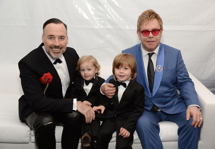 David Furnish, Elijah Furnish-John, Zachary Furnish-John, and Sir Elton John attend the 23rd Annual Elton John AIDS Foundation Academy Awards Viewing Party on February 22, 2015, in Los Angeles, California.