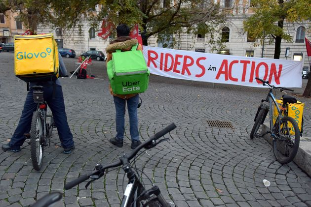 ROME, ITALY - NOVEMBER 14: Food delivery riders assemble with their bags and bicycles, to protest for...