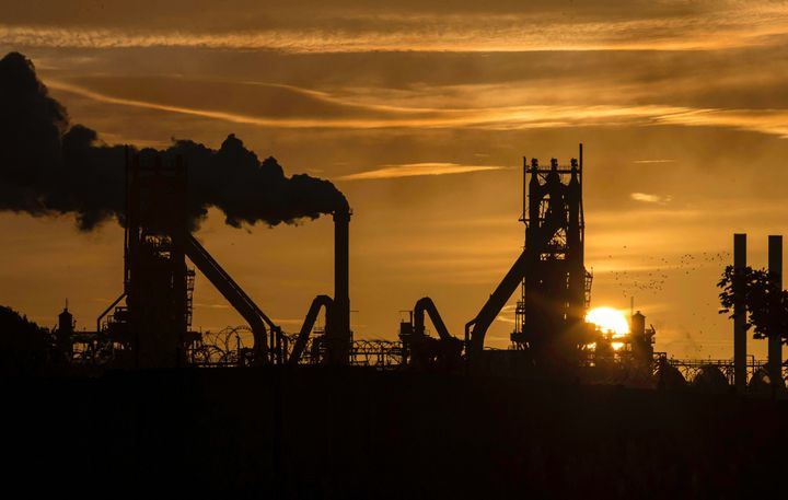 The sun rises behind a steel plant in north Lincolnshire, England, Sept. 28, 2016.