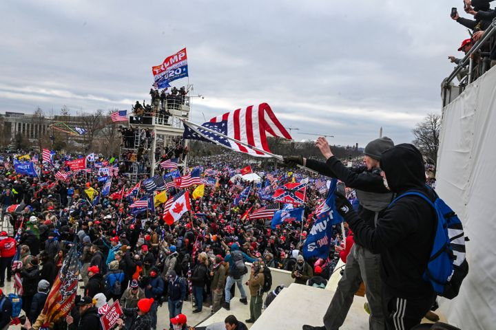 The man dubbed #SoggyKidInsider (in the foreground, holding the flag) at the Capitol on Jan. 6.