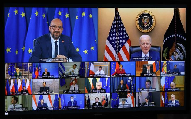 BRUSSELS, BELGIUM - MARCH 25: A screen shows U.S. President Joe Biden (Top R) attending virtual EU Leaders'...
