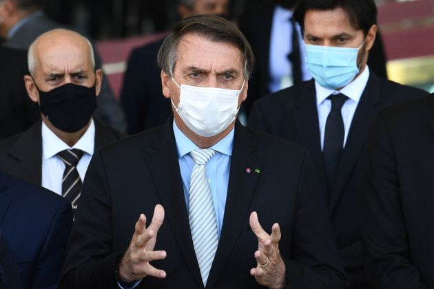 Brazilian President Jair Bolsonaro speaks to the press after meeting with the heads of the three government...