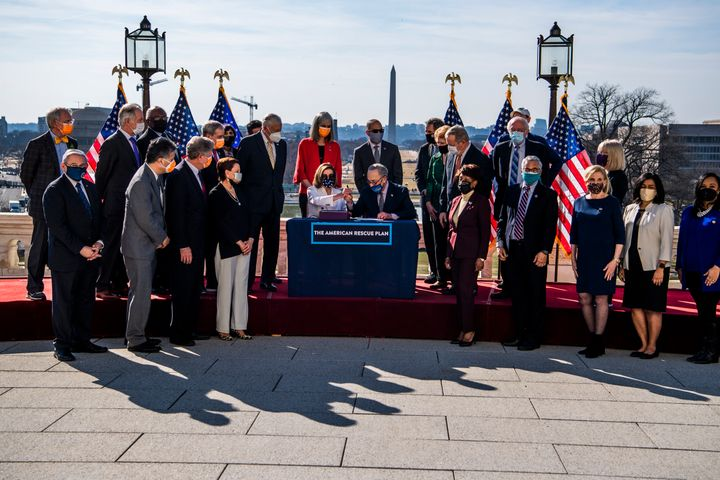 Speaker of the House Nancy Pelosi and Senate Majority Leader Chuck Schumer sign the American Rescue Plan on March 10, 2021, a