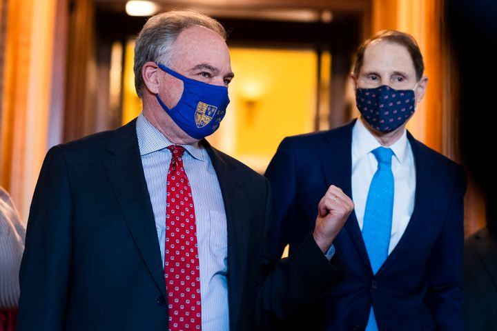 Sens. Tim Kaine (D-Va.) and Ron Wyden (D-Ore.) in the Capitol on March 23, 2021. In explaining why the American Rescue Plan d