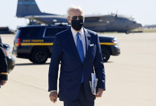 US President Joe Biden walks towards the press after disembarking from Airforce One after arriving in...