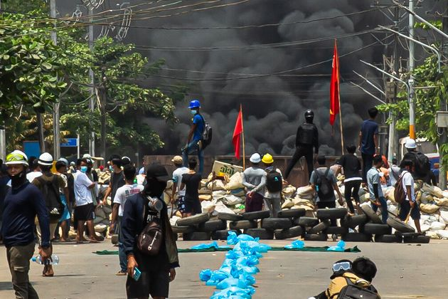YANGON, MYANMAR - MARCH 27: Smoke rises after protesters burn tyres as they gather to continue their...
