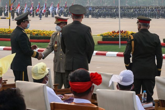 Guests are greeted as they attend an annual parade put on by the military to mark Armed Forces Day in...
