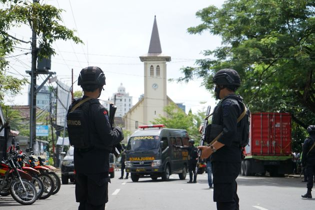 MAKASSAR, INDONESIA - MARCH 28: Police officer stand guard in the front of Makassar Cathedral Church...