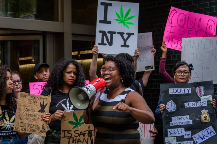 People are seen demonstrating in 2019 outside the New York governor's office in Manhattan in support of regulating marijuana.