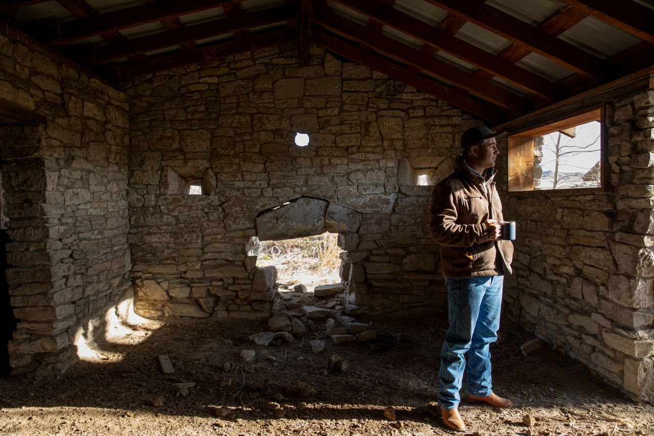 Elias Eiguren walks through a historic fort building that stands on the family's property near Arock, Oregon, on March 27.
