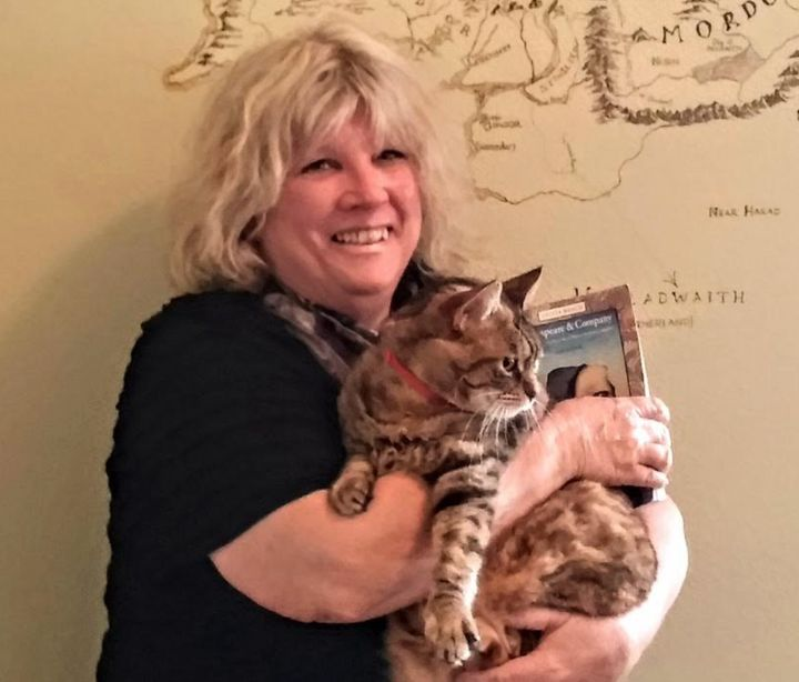 The author's mother in the J.R.R. Tolkien Room at Sylvia Beach Hotel in Nye Beach, Oregon, with the resident cat in 2014.