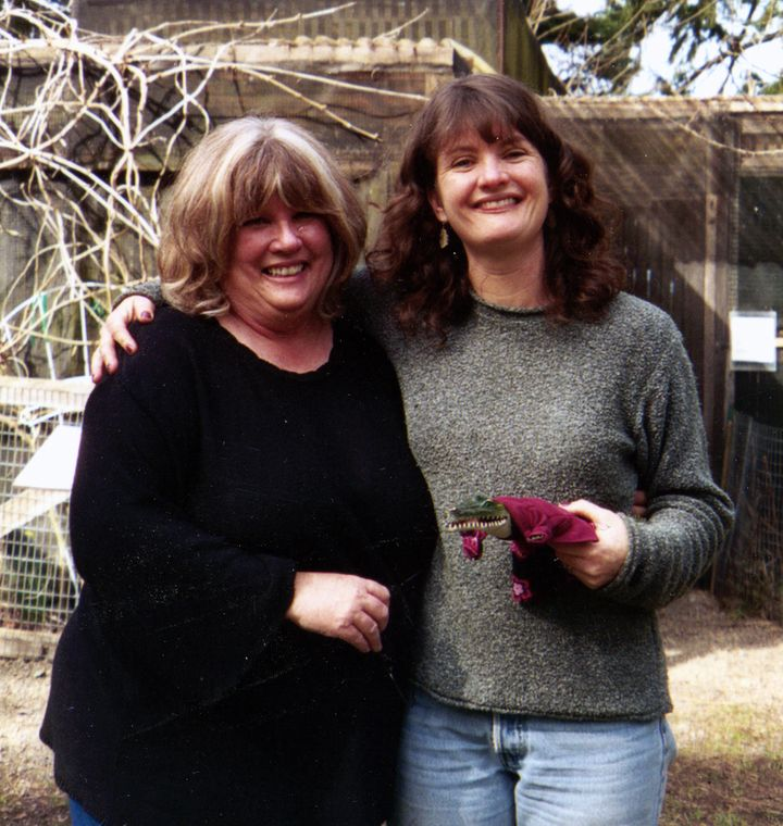 The author and her mother at the Cascade Raptor Center in Eugene, Oregon, in 2005, posing with the plastic costumed alligator