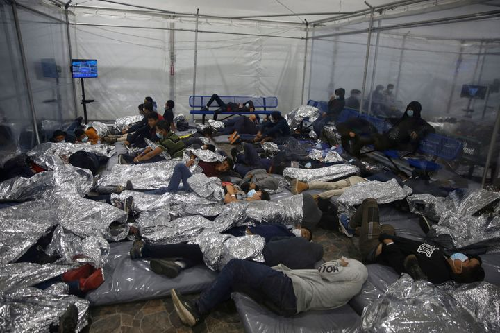 Young children rest inside a pod at the Donna Department of Homeland Security holding facility, the main detention center for