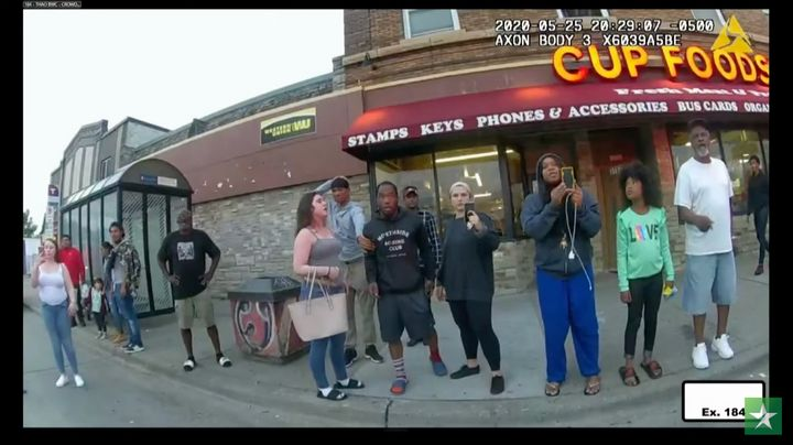 In this still image from the night of George Floyd's arrest, Alyssa Funari can be seen on the far left in white, Kaylynn Gilb