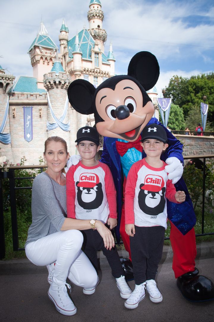 Celine Dion and twin sons Eddy and Nelson celebrate the boys' fifth birthday with Mickey Mouse at Disneyland in Anaheim, California, in October 2015.
