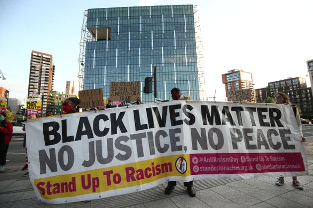 Protesters outside the US Embassy in London, as part of an anti-racism demonstration coinciding with...
