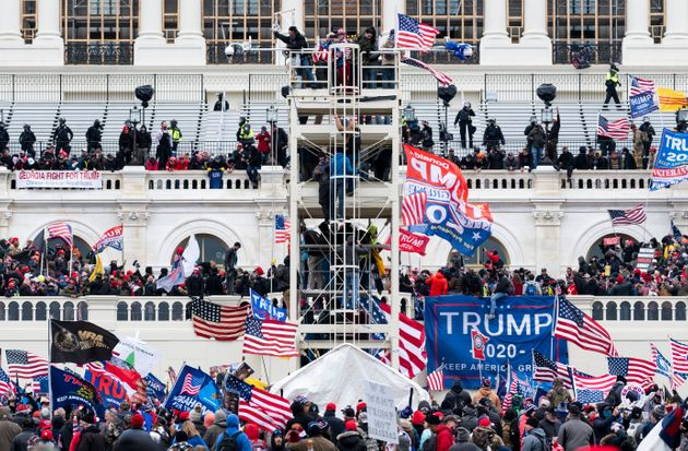 Trump supporters occupy the West Front of the Capitol and the inauguration stands during the January...