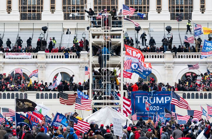 Trump supporters occupy the West Front of the Capitol and the inauguration stands during the Jan. 6 insurrection.