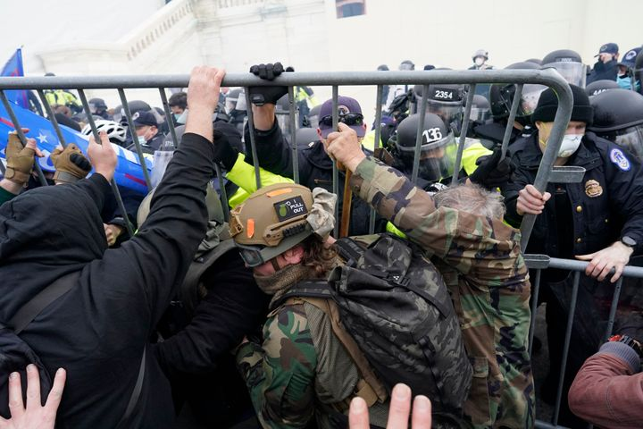 Police try to hold back protesters attempting to halt a joint session of the 117th Congress in Washington on Jan. 6.