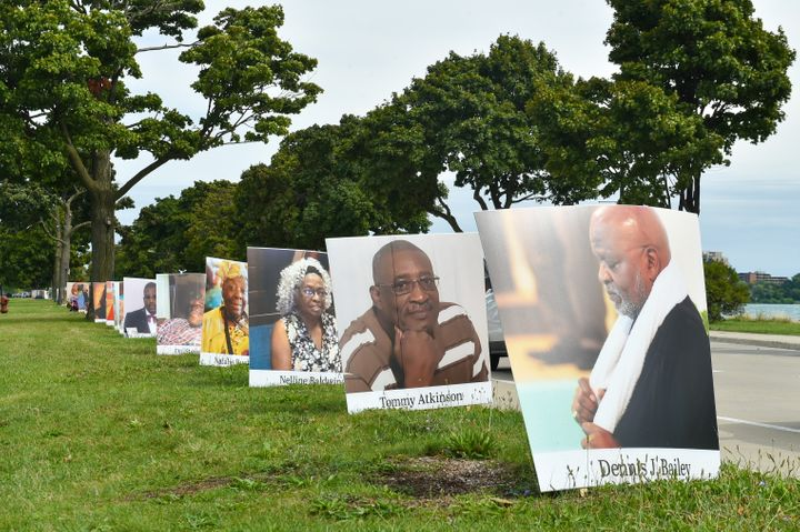 Images of COVID-19 victims from Detroit are displayed in a drive-by memorial at Belle Isle State Park on Sept. 2, 2020 in Det