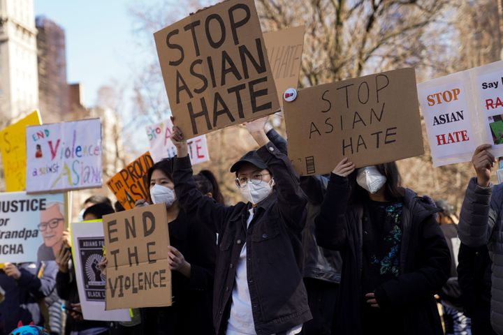 The trauma, anxiety and fear experienced by people in Asian, Asian American and Pacific Islander communities carries over into the workplace, too.Above, people take part in a protest against Asian hate in New York on March 21.