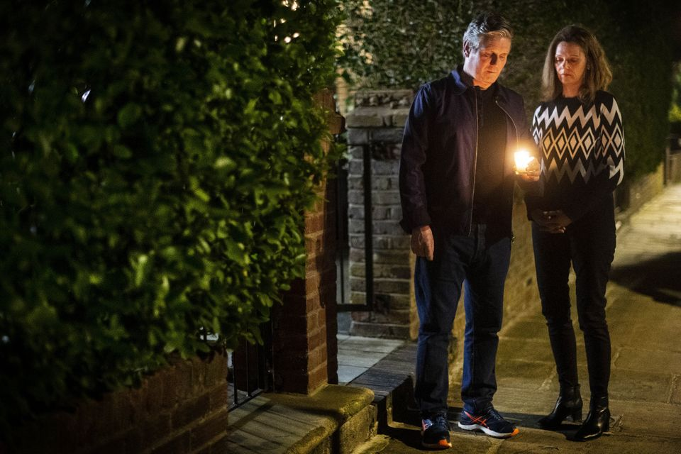Keir Starmer and his wife Victoria hold a candle for Sarah