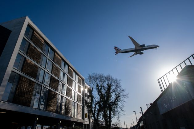 A British Airways airplane flies over a Travelodge hotel as it comes in to land at Heathrow