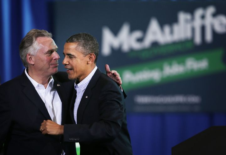 Terry McAuliffe greets then-President Barack Obama at a rally for McAuliffe's first gubernatorial bid. Obama's support was cr